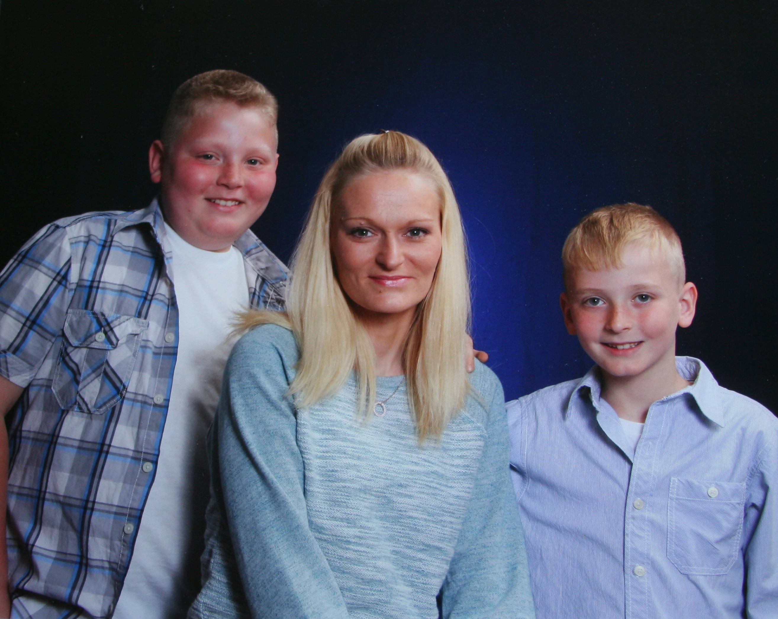 A photo taken as a school fundraiser during the school year with Hunter Jones, Natasha Fugate Jones, and Conner Jones.